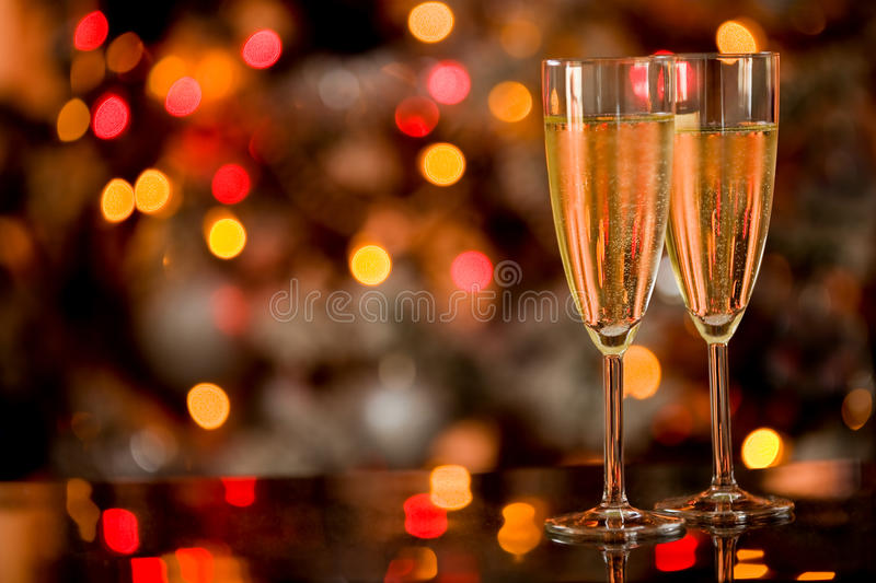 Champagner on Glass Table with Bokeh background. Photo of two champagner glasses on glass table with bokeh background stock image