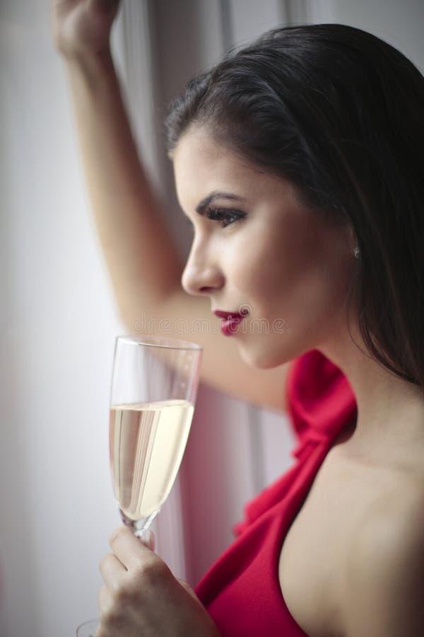 Champanhe bebendo da mulher imagem de stock royalty free