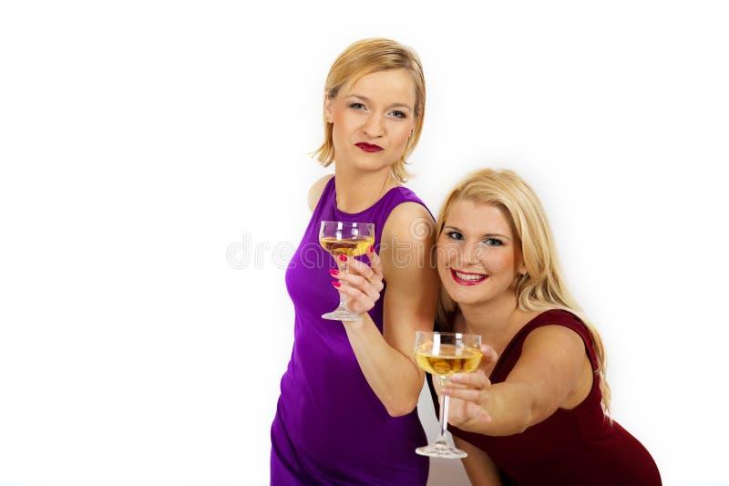 Champanhe bebendo da mulher bonita do Natal dois imagem de stock royalty free