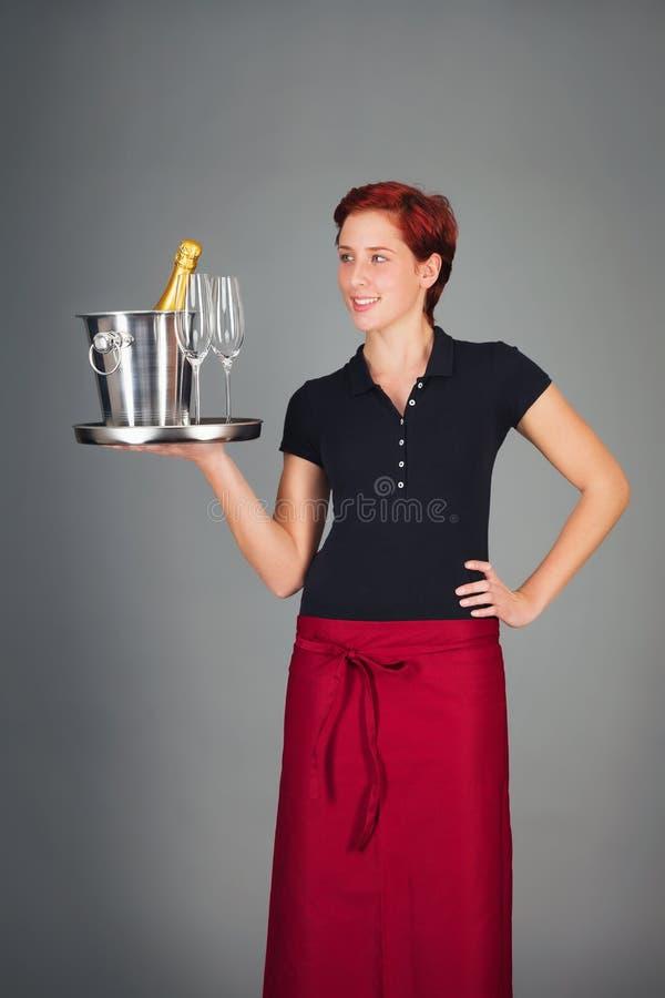 Champanhe do serviço da empregada de mesa foto de stock royalty free