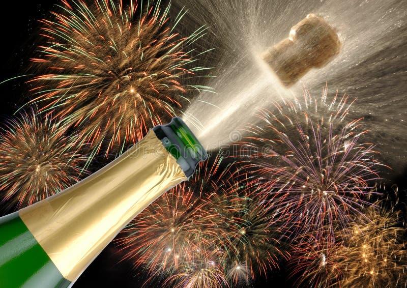 Champanhe e fogos-de-artifício do frasco fotos de stock