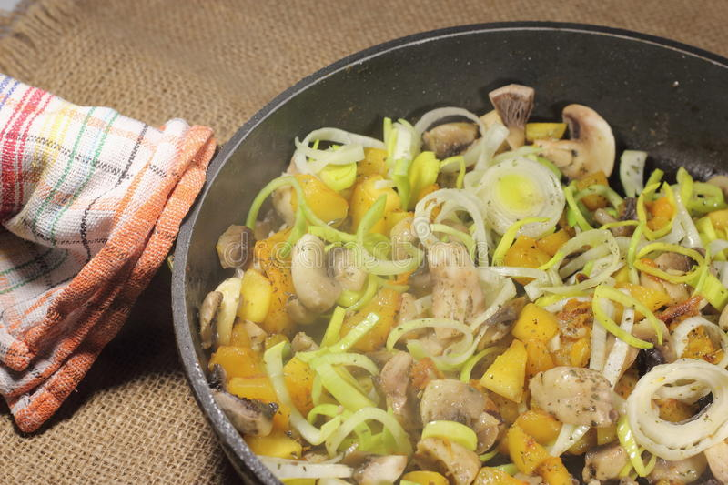 Champignons with vegetables. And Provencal herbs on the sliced pieces and fried. soft focus royalty free stock images