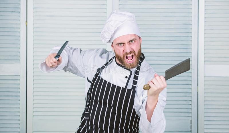 He is a champion in the kitchen. angry bearded man with knife. love food. cook in restaurant. chef ready for cooking. Confident man in apron and hat stock images