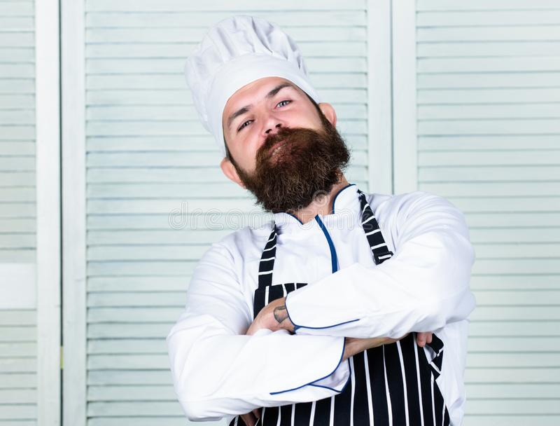 He is champion in the kitchen. Confident bearded strong chef white uniform. Become chef at restaurant. Professional chef. Proud to be master chef. Feel so cool stock images