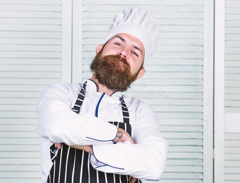 He is champion in the kitchen. Confident bearded strong chef white uniform. Become chef at restaurant. Professional chef. Proud to be master chef. Feel so cool stock photography