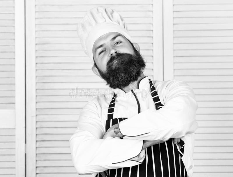 He is champion in the kitchen. Confident bearded strong chef white uniform. Become chef at restaurant. Professional chef. Proud to be master chef. Feel so cool stock photo