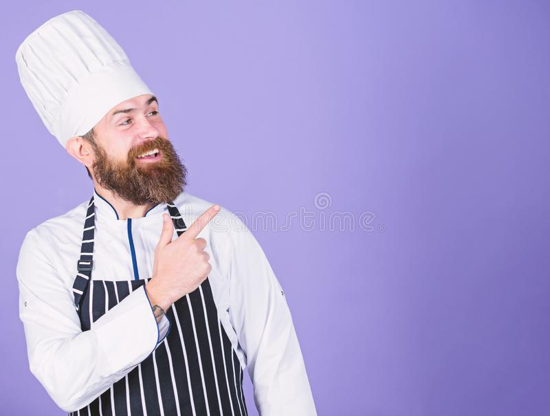 He is a champion in the kitchen. Perfect chef with neat look. Professional chef in cook uniform. Happy bearded man in. Apron. copy space. restaurant cuisine royalty free stock photos