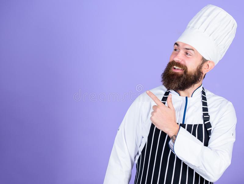 He is a champion in the kitchen. Perfect chef with neat look. Professional chef in cook uniform. Happy bearded man in. Apron. copy space. restaurant cuisine stock photo