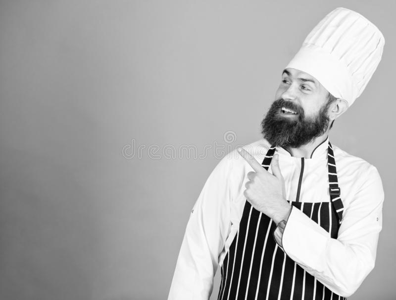 He is a champion in the kitchen. Perfect chef with neat look. Professional chef in cook uniform. Happy bearded man in. Apron. copy space. restaurant cuisine royalty free stock photography