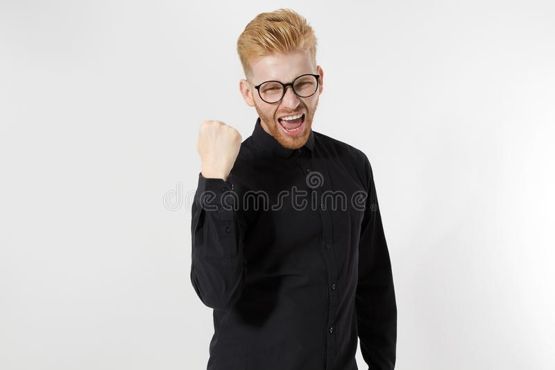 Champion, life winner concept. Young successful entrepreneur with Strong ambitions, passion be number one. Handsome man. With redhead, red beard in stylish stock photo