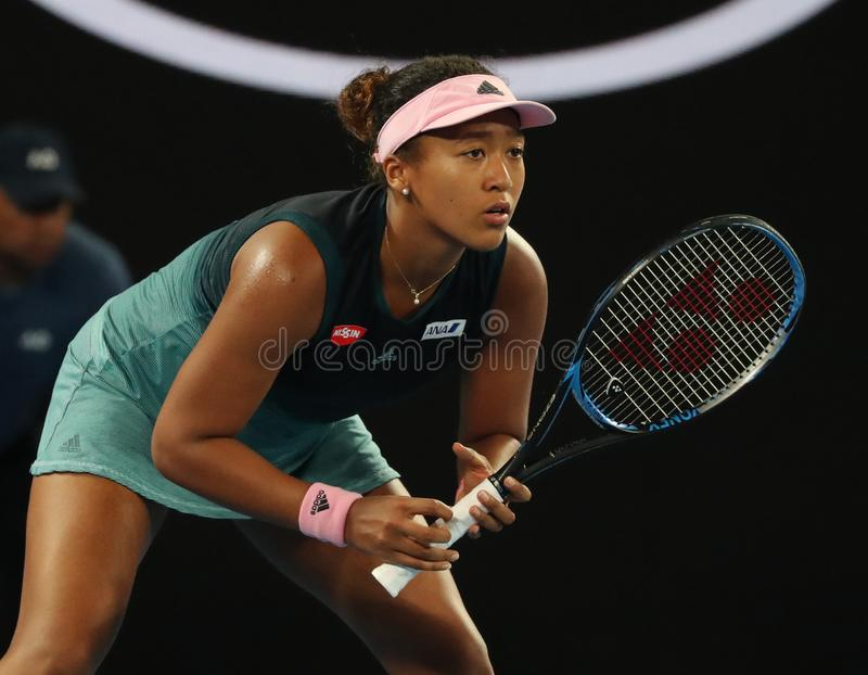 Champion Naomi Osaka de Grand Slam du Japon dans l'action pendant son match de demi-finale à l'open d'Australie 2019 en parc de M photo stock
