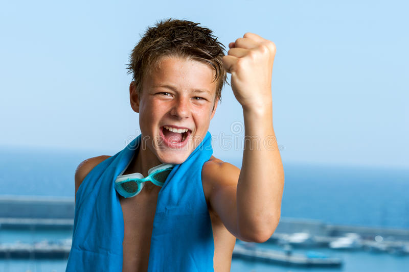 Champion teen swimmer pulling a fist. stock images