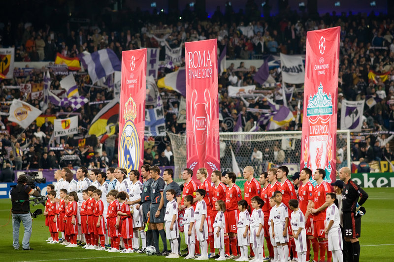Champions League. MADRID - FEB. 25, 2009: Real Madrid and Liverpool players line up before the beginning their Champions League second round match. MADRID - FEB royalty free stock photos