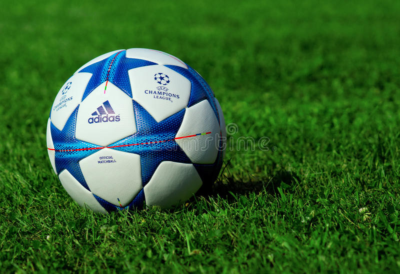 Champions league ball. ZAGREB , CROATIA - 13 AUGUST 2015 - close up of European champions league official machball football from Adidas on the grass field royalty free stock image
