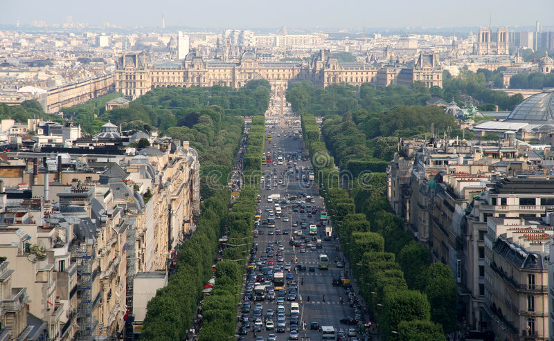 Champs Elysee. The Champs Elysee and the Louvre in the distance, seen from the roof of the Arc de Triomphe stock photo