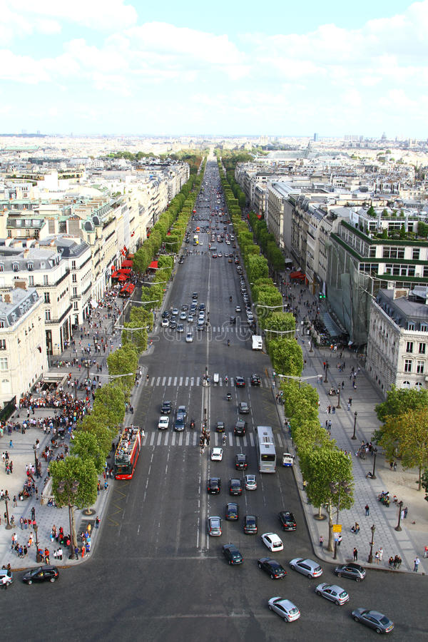 Champs Elysee, Paris. Paris, France. The Champs Elysee with traffic in Paris, France as seen from the Arc de Triomphe with the Louvre museum in the distance stock images