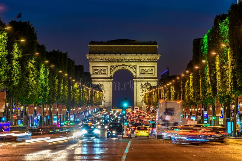 Champs-Elysees and Arc de Triomphe at night in Paris royalty free stock photography