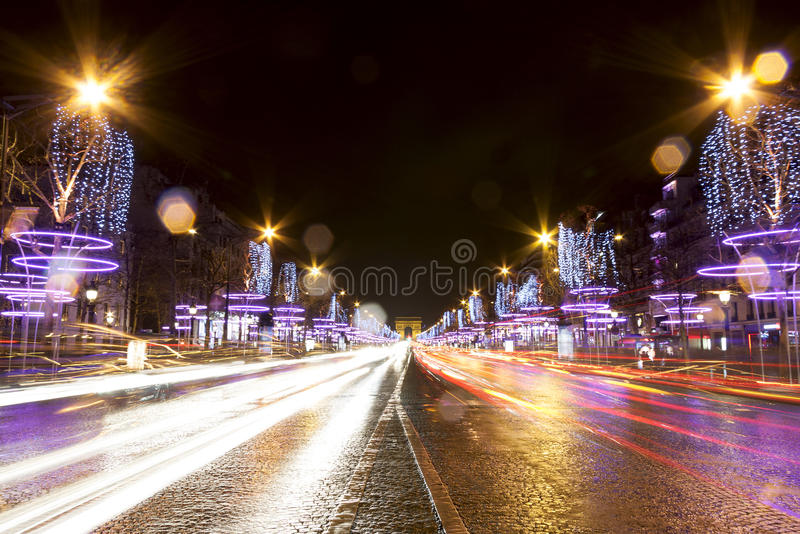 Champs-Elysees street at night in Paris royalty free stock images