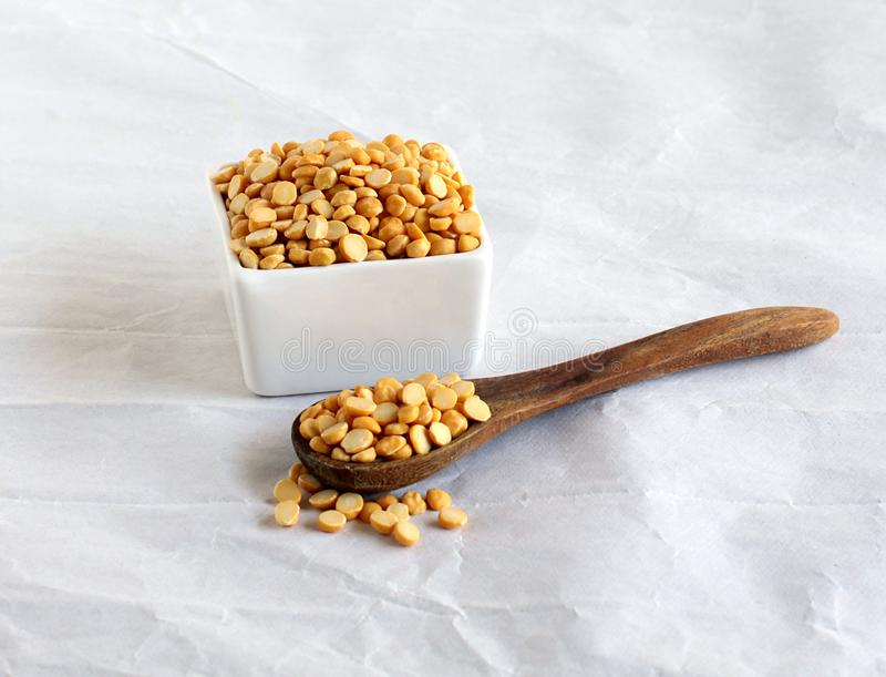 Chana Dal or Split Chickpea Common Indian Food Ingredient. Chana dal or split chickpea, which is a common Indian lentil and an ingredient in food items like dal stock photos