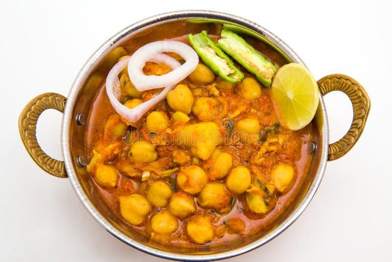 Chana Masala - ένα ινδικό πικάντικο χορτοφάγο πιάτο για το μεσημεριανό γεύμα και το DIN στοκ εικόνες με δικαίωμα ελεύθερης χρήσης
