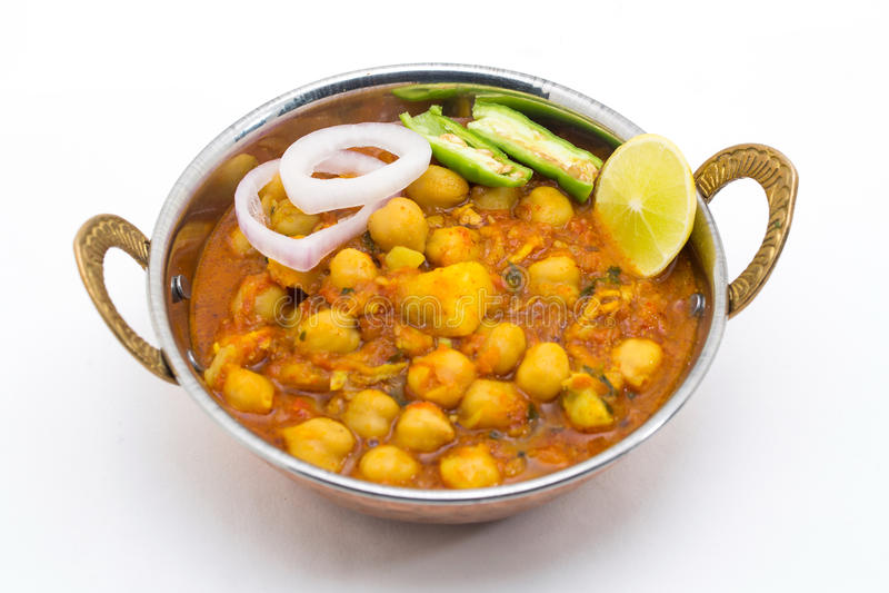 Chana Masala - ένα ινδικό πικάντικο χορτοφάγο πιάτο για το μεσημεριανό γεύμα και το DIN στοκ εικόνες