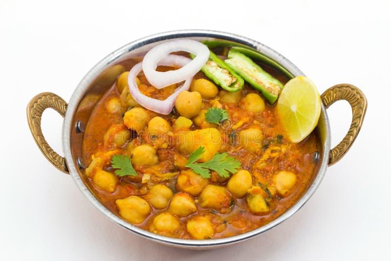 Chana Masala - ένα ινδικό πικάντικο χορτοφάγο πιάτο για το μεσημεριανό γεύμα και το DIN στοκ εικόνα με δικαίωμα ελεύθερης χρήσης