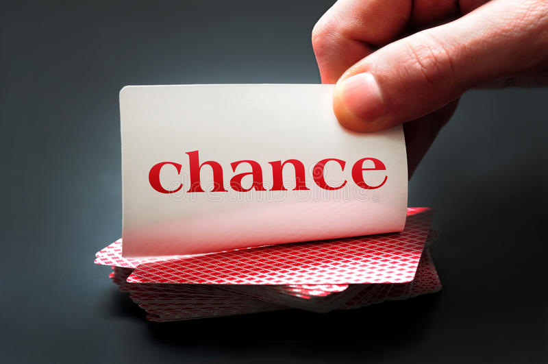 Chance card. On black table royalty free stock photos