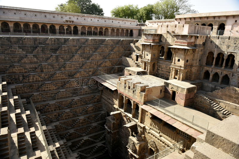 Chand Baori Step Well. India. India village of Abhaneri is in it a reservoir for rainwater. The stone stairs lay into a mystical, deceptive space. Fantastic stock photos