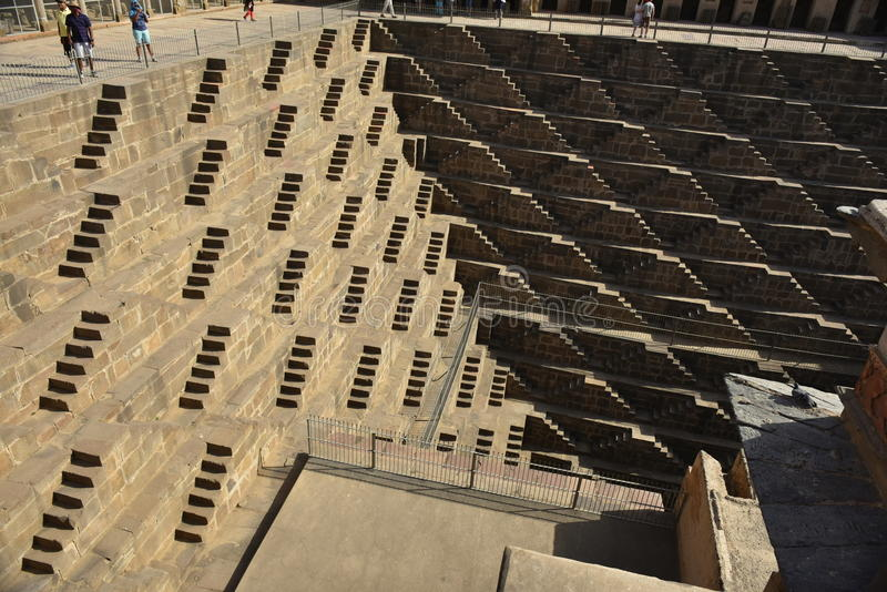Chand Baori Step Well. India. India village of Abhaneri is in it a reservoir for rainwater. The stone stairs lay into a mystical, deceptive space. Fantastic royalty free stock photography