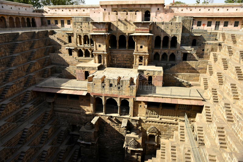 Chand Baori Step Well. India. India village of Abhaneri is in it a reservoir for rainwater. The stone stairs lay into a mystical, deceptive space. Fantastic stock image