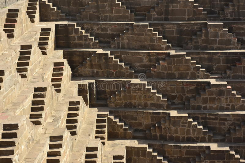 Chand Baori Step Well. India. India village of Abhaneri is in it a reservoir for rainwater. The stone stairs lay into a mystical, deceptive space. Fantastic stock images