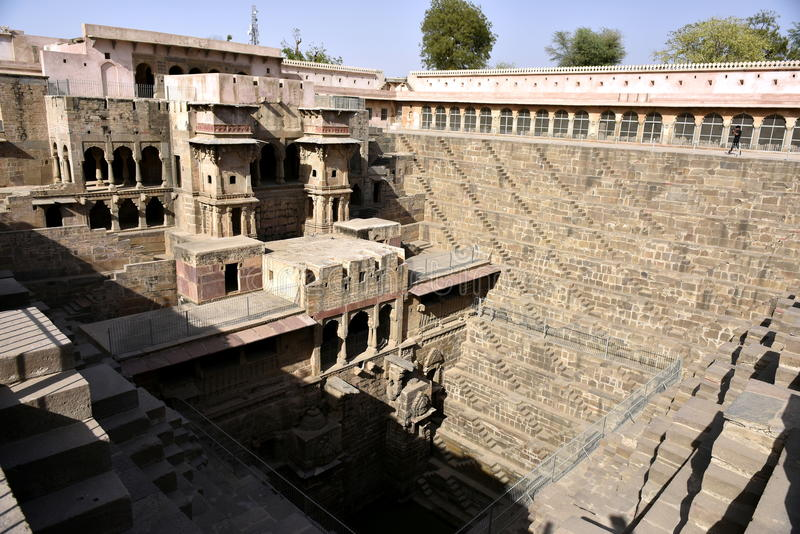 Chand Baori Step Well. India. India village of Abhaneri is in it a reservoir for rainwater. The stone stairs lay into a mystical, deceptive space. Fantastic royalty free stock images
