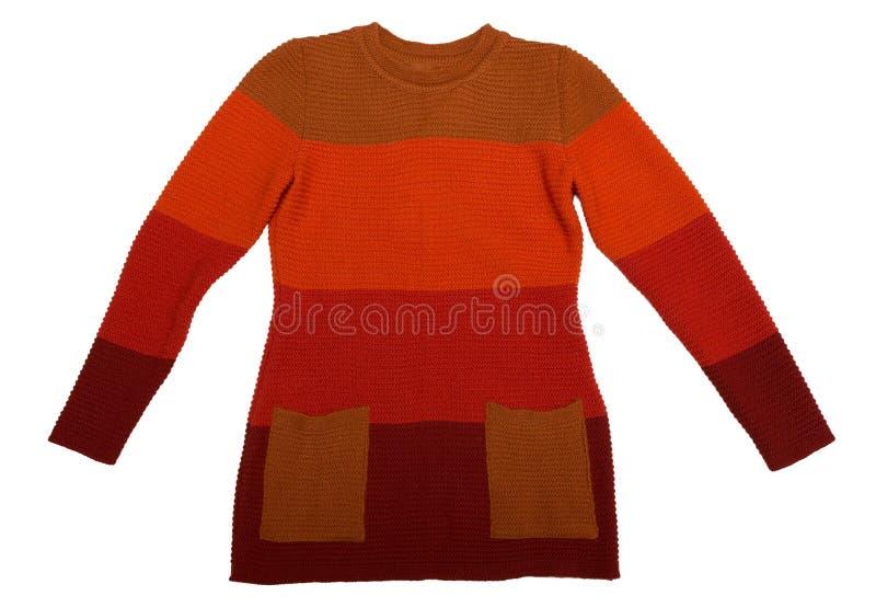 Chandail orange tricoté par femelle Isolat sur le blanc photo libre de droits