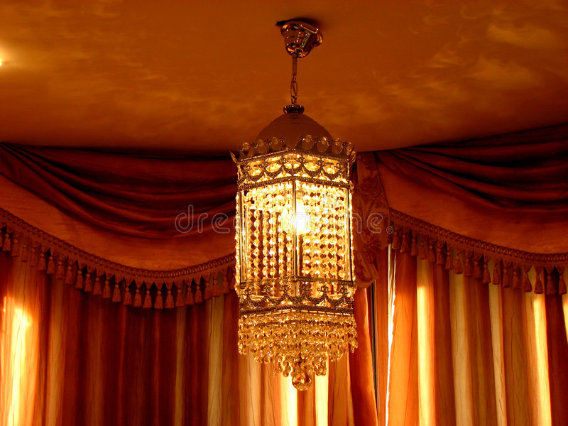 Chandelier. A beautiful antique chandelier in a house stock images