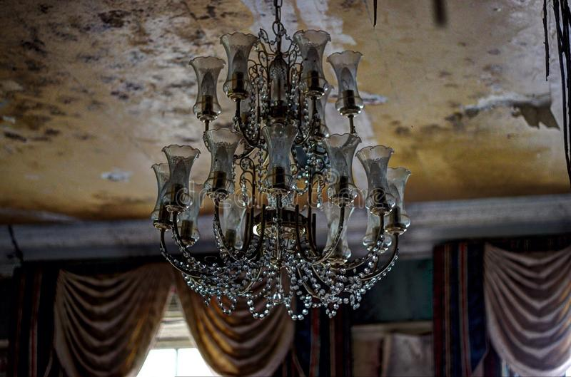 Chandelier at abandoned Manor House stock photography
