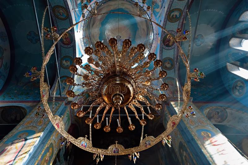 The chandelier in Assumption Cathedral in Volodymyr-Volynskyi in Ukraine. Volodymyr-Volynskyi / Ukraine - October 31 2018: The chandelier in Assumption Cathedral stock photography