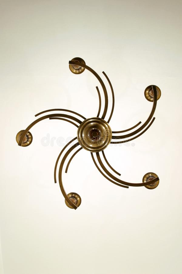 Old Chandelier Designed in Art Deco Style hanging from the ceiling 7585a stock photos