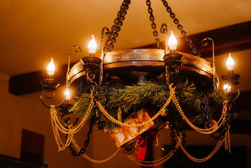Chandelier hanging from the ceiling in a castle with christmas decorations stock photography