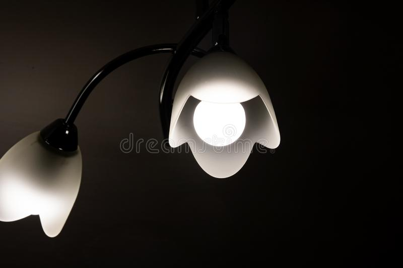 Chandelier with a lamp in the dark. Close up stock images