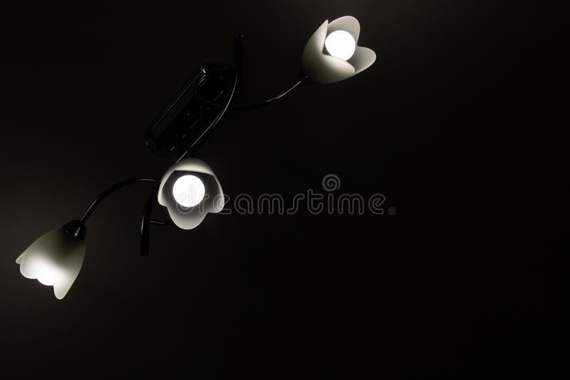 Chandelier with a lamp in the dark. Close up stock photography