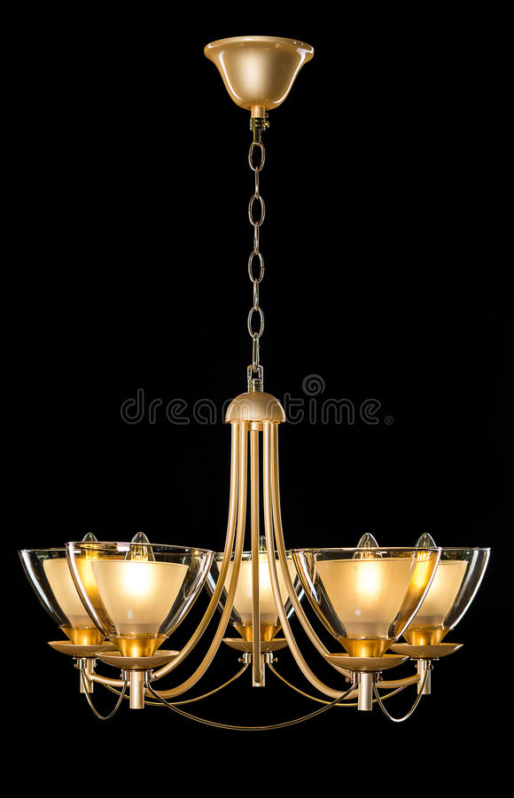 Chandelier light in interior on black background. Soft ligting royalty free stock photography