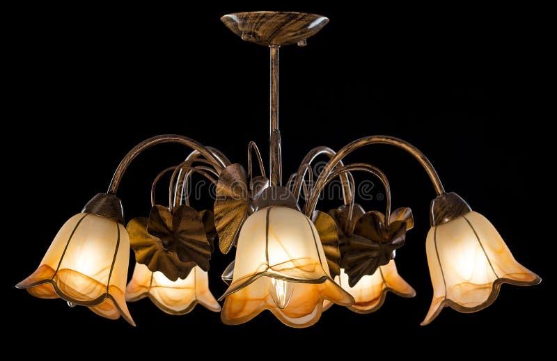 Chandelier light in interior on black background. Soft ligting stock photography