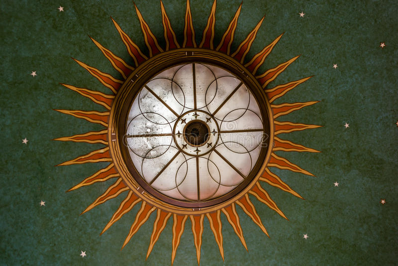 Chandelier looking like a beautiful art deco pattern. Chandelier taken from below looking like a beautiful art deco pattern royalty free stock images