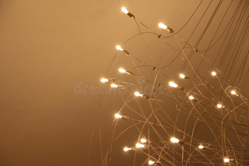 Chandelier with many lightbulbs on red background royalty free stock photos