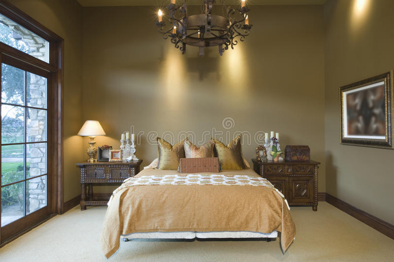Chandelier Over Bed At Home Royalty Free Stock Photo - Image: 33905165
