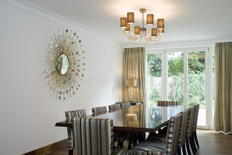 Chandelier over dining table and art on wall stock image image of download chandelier over dining table and art on wall stock image image of simplicity aloadofball Image collections