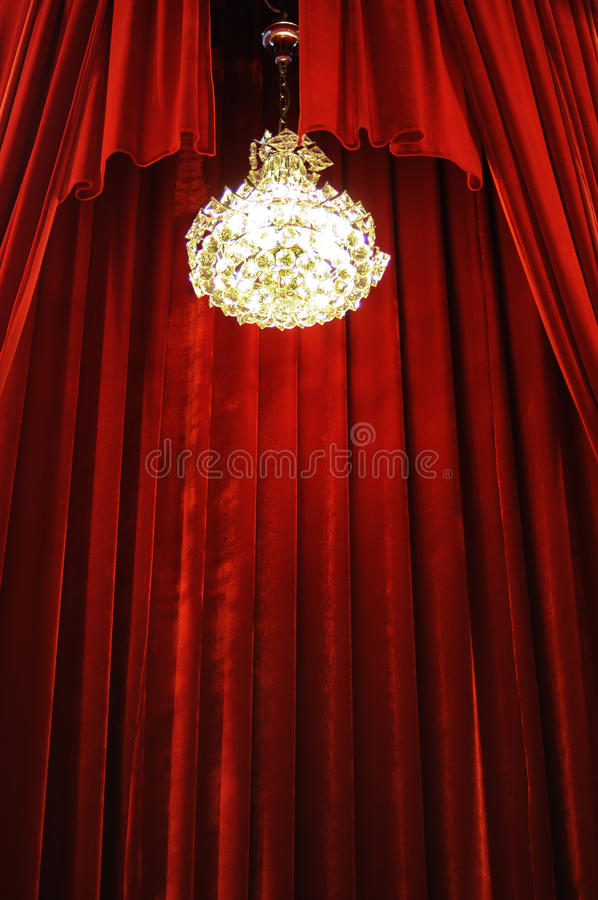 Chandelier with red curtains royalty free stock photography