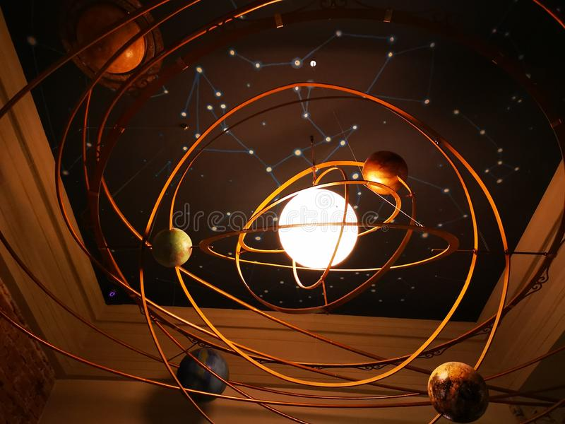 Chandelier solar system model design. In the center the sun shines stock images