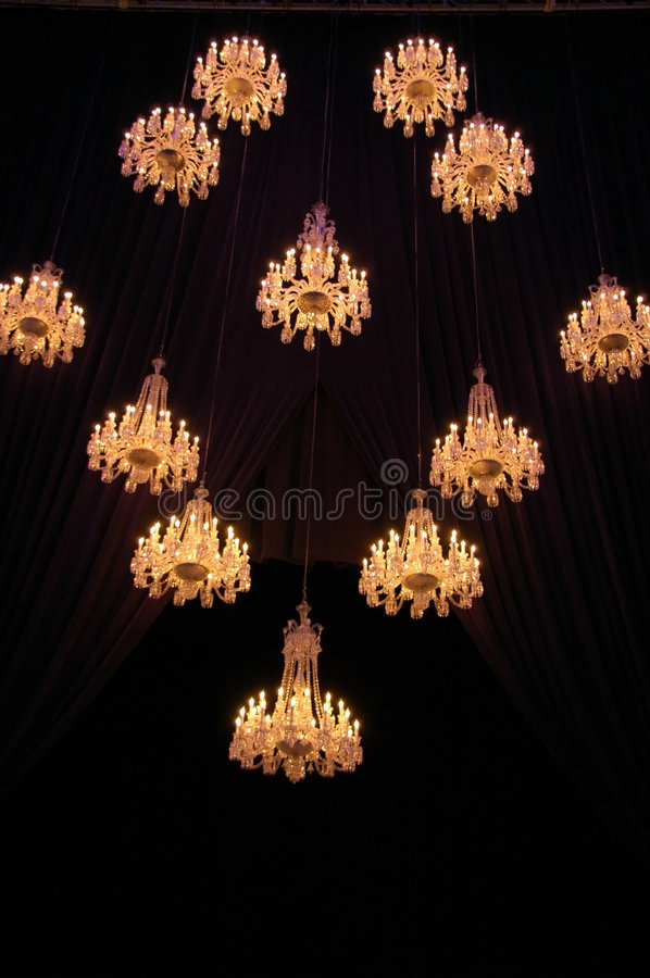 Chandeliers. Beautiful chandeliers brightens up the ballroom royalty free stock photos