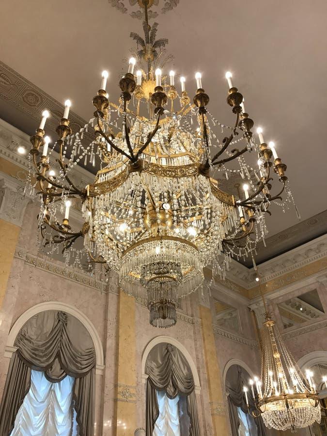 Chandeliers in the Albertina Museum, Vienna, Austria. Oct 2017: Elegant chandeliers hang above the Habsburg state rooms in the Albertina Museum in Vienna stock photography